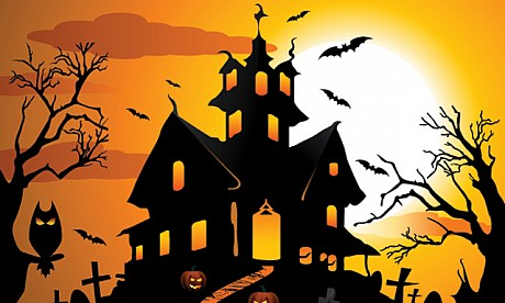 black silhouette of haunted house orange background and spooky bats and owl